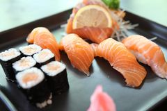 Salmon Sushi set. On a plate stock photography