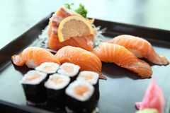 Salmon Sushi set. On a plate stock images