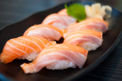 Salmon Sushi Set on Black Dish Stock Image