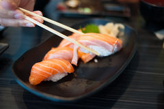 Salmon Sushi Set on Black Dish Stock Images