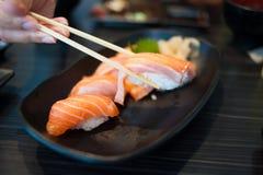 Salmon Sushi Set on Black Dish Stock Images
