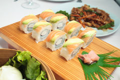 Salmon sushi set. Salmon sushi rolls set on a wooden plate Stock Images