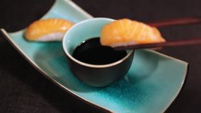 Salmon sushi and soy sauce. stock video