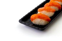 Salmon Sushi sulla banda nera Immagine Stock Libera da Diritti