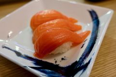 Salmon sushi with white plate. royalty free stock photos