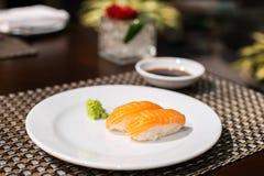 Salmon sushi. On the white plate Royalty Free Stock Photos