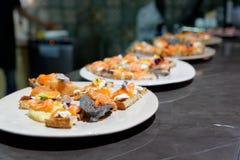 Salmon tapas on kitchen counter royalty free stock photos