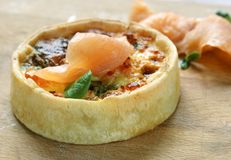 Salmon tart with herbs Stock Images