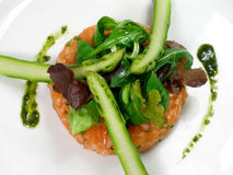 Salmon tartar with asparagus and salad. Salmon tartar with asparagus, salad and pesto stock images