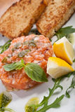 Salmon tartar. With lemon and toasts Royalty Free Stock Image