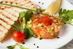 Salmon Tartar on a light background. Starter close Stock Photos