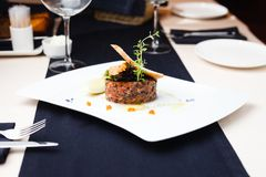 Salmon tartar with red caviar Stock Photo