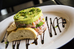 Salmon tartar with Sour cream, Avocado and chives Stock Photo