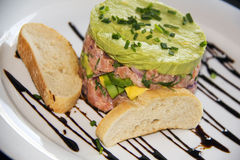 Salmon tartar with Sour cream, Avocado and chives Stock Images