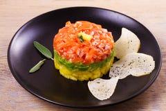 Salmon tartare with avocado and mango Stock Photography