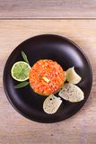 Salmon tartare with avocado and mango Royalty Free Stock Image