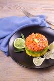 Salmon tartare with avocado and mango Royalty Free Stock Photos