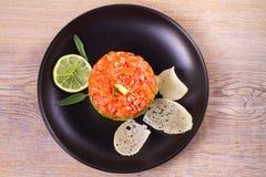 Salmon tartare with avocado and mango Stock Image