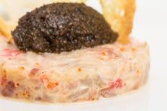 Salmon tartare with black truffle sauce. Stock Photography