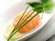 Salmon tartare with lemon stock photos