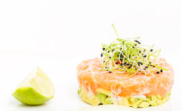 Salmon tartare with sprouts and red caviar. Royalty Free Stock Photography