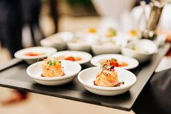 Salmon tatrar in small plates, catering event. Banquet food stock image