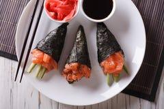 Salmon temaki sushi, ginger and sauce closeup. horizontal top vi Stock Image