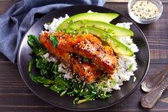 Salmon teriyaki rice bowl with spinach and avocado. Salmon teriyaki rice bowl with spinach and avocado stock photos