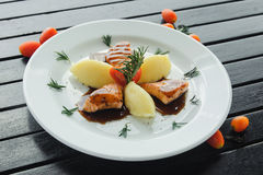 Salmon in teriyaki sause with mashed potatoe on white plate Royalty Free Stock Image
