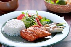 Salmon teriyaki served with rice and salad Stock Image
