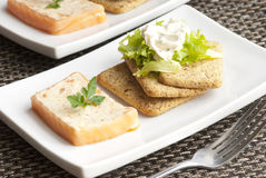 Salmon terrine. Smoked salmon and dill terrine with biscuits and lettuce Royalty Free Stock Images