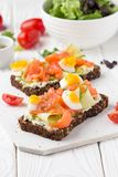 Salmon toast with cream cheese, cucumber and egg. Delicious lunch, healthy food, fish sandwich, diet snack. Salmon toast with cream cheese, cucumber and egg royalty free stock photo