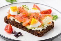Salmon toast with cream cheese, cucumber and egg. Delicious lunch, healthy food, fish sandwich, diet snack. Salmon toast with cream cheese, cucumber and egg stock photos