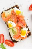 Salmon toast with cream cheese, cucumber and egg. Delicious lunch, healthy food, fish sandwich, diet snack. Salmon toast with cream cheese, cucumber egg stock photo