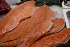 Salmon. Tranches of salmon on ice on a fish market Stock Photo