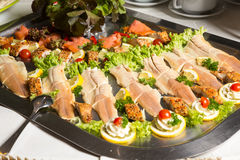 Salmon on a tray at buffet in restaurant Stock Photography