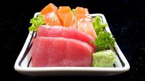 Salmon and tuna sashimi plate with an assortment of fresh raw fish.  Royalty Free Stock Photo