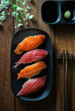 Salmon and tuna sushi with chopsticks Royalty Free Stock Photos