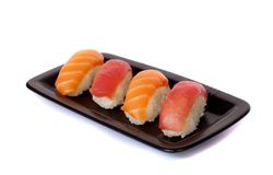 Salmon and tuna sushi on a plate Stock Photos