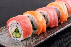 Salmon & tuna sushi roll Stock Images