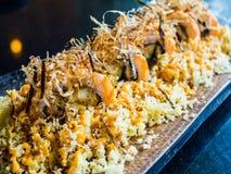 Salmon unagi ebi tempura roll. Japanese modern food Royalty Free Stock Photo