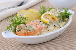 Salmon with cream and lemon sauce. Salmon under gentle creamy lemon sauce with spices Stock Photo