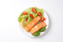 Salmon with vegetable garnish Royalty Free Stock Image