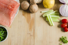 Salmon and vegetables background for recipe Stock Photography