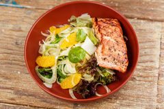 Salmon with vegetables Fish with orange salad stock photos