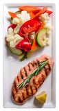 Salmon with vegetables. Grilled salmon with steaming vegetables Royalty Free Stock Photo