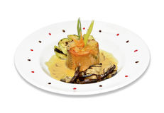 Salmon with sauce and vegetables. Isolated grilled salmon with cream dill sauce on a plate with veggies Stock Photo