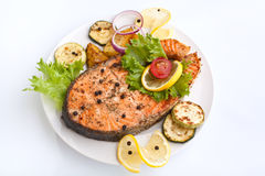 Salmon with vegetables and lemon Royalty Free Stock Photos