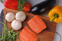 Salmon with vegetables and mushrooms Royalty Free Stock Photos