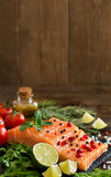 Salmon with vegetables, olive oil and herbs Stock Image